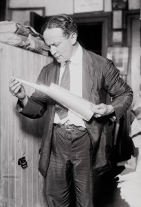 Houdini holding Collapsible Trumpet