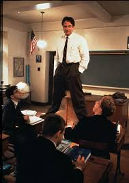 Robin Williams standing on desk, from Dead Poets Society movie