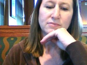 Julie sitting at laptop